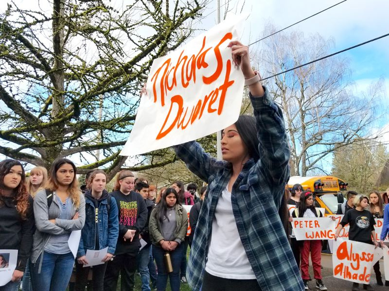 OUTLOOK PHOTO: STEVE BROWN  - Citlaly Arroyo, a senior at Gresham High School, was among the organizers of the student walkout Wednesday morning at the school, where she led her fellow students in observing a minute of silence for each of 17 people killed in the Parkland, Fla., school shooting on Feb. 18.