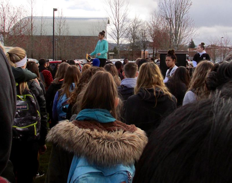OUTLOOK PHOTO: TERESA CARSON - Reynolds High School student organizer Divine Robertson, a 17-year-old junior, spoke to a crowd of pupils on Wednesday, March 14, during a protest against school shootings.