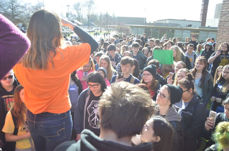 SPOTLIGHT PHOTO: NICOLE THILL - Students at St. Helens High School particpated in a national school walkout protest on March 14. Students wore t-shirts, stickers, and help up signs with the message that enough is enough when it comes to school shootings and they want to feel safe in their schools.