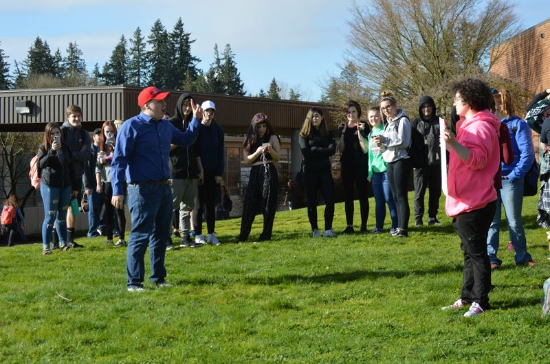SPOTLIGHT PHOTO: NICOLE THILL - Students at St. Helens High School were met by a group of student counter protesters Wednesday morning. The counter protesters were advocating for gun rights and chatted sloagns in support of President Donald Trump.