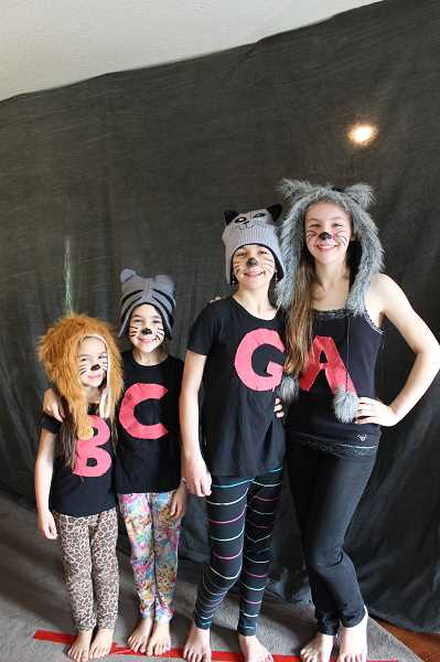 PIONEER PHOTO: KRISTEN WOHLERS - The Peterson girls participated in Oregon Connection Academy's 'Dr. Seuss Live Lessons Friday' on March 2. From left to right, the girls are Raquel, Audrey, Grace and Ingrid.