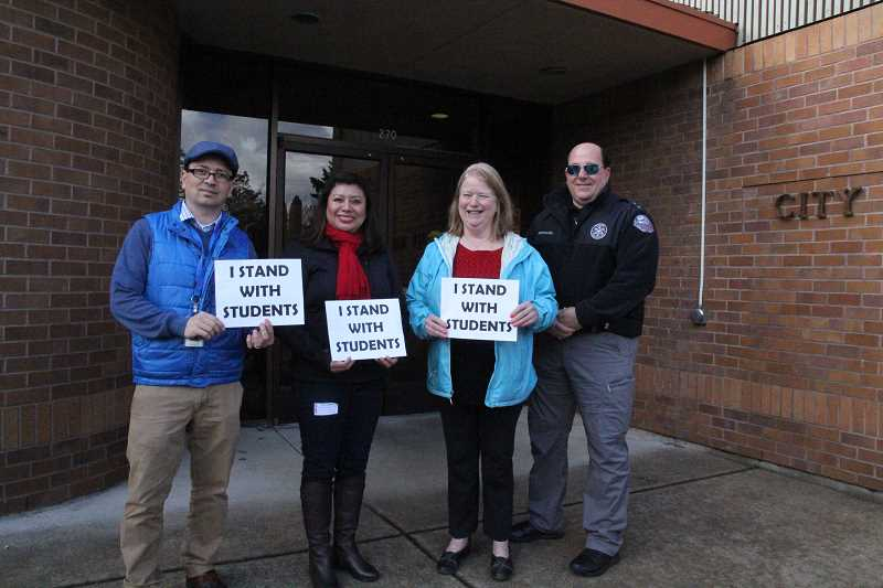 LINDSAY KEEFER - Local leaders showed support for students who participated in Wednesday's walkout, including State Rep. Teresa Alonso Leon (second from left). She's joined by (from left) Woodburn Community Relations Manager and school board member Gustavo Gutierrez-Gomez, Woodburn Mayor Kathy Figley and Woodburn Police Chief Jim Ferraris.