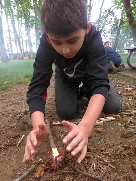 SUBMITTED PHOTO: COYLE OUTSIDE - Kids will learn to build a quick fire, among many other skills, during the Coyle Outside Wild Survival camp March 26.