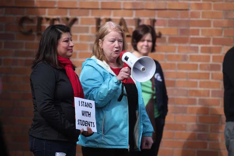 PHIL HAWKINS - Woodburn Mayor Kathy Figley addresses the crowd of students who marched from Woodburn High School to City Hall Wednesday.
