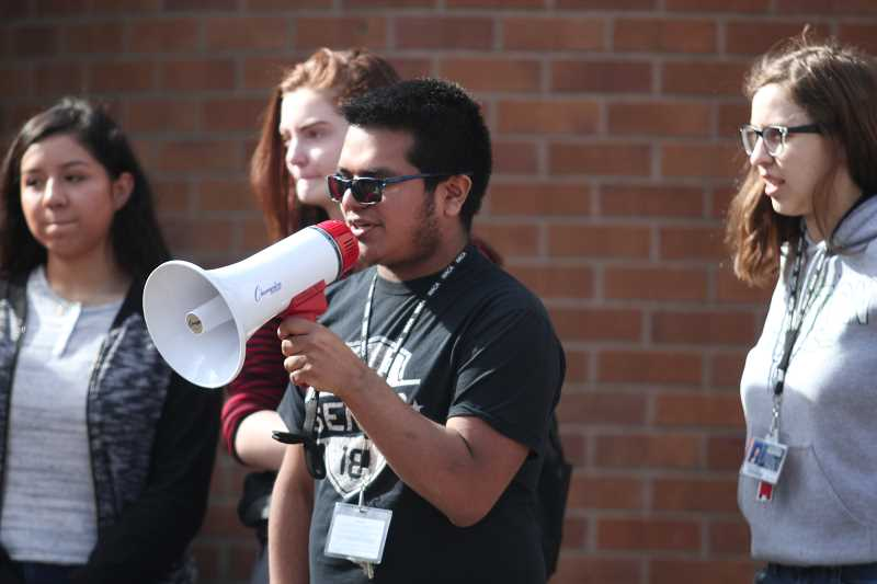 PHIL HAWKINS - Juan Arriaga, a senior at Woodburn High School who organized Wednesday's protest in Woodburn, addressed the crowd of nearly 100 students who marched from the school to City Hall.