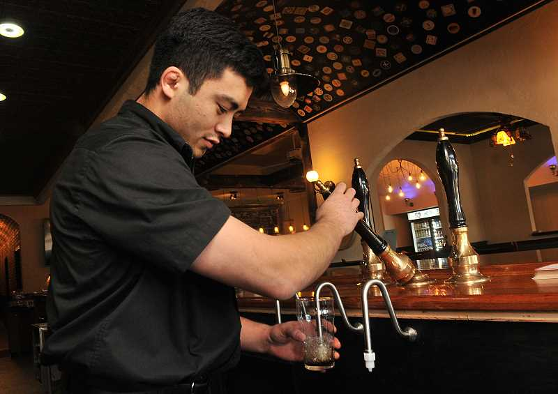 Toney Chay pours from one of the cask taps at the Willamette Ale & Cider House.