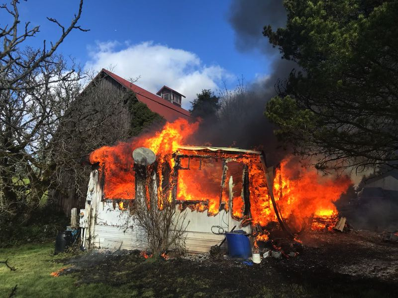 COURTESY PHOTO: CORNELIUS FIRE DEPARTMENT - Firefighters from the Cornelius Fire Department and other local agencies reportedly arrived to the scene of a fire off Gnos Road south of Cornelius to find a mobile home up in flames Wednesday.