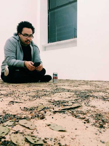Artist manuel arturo abreu in the midst of installation, Portland, Ore.
