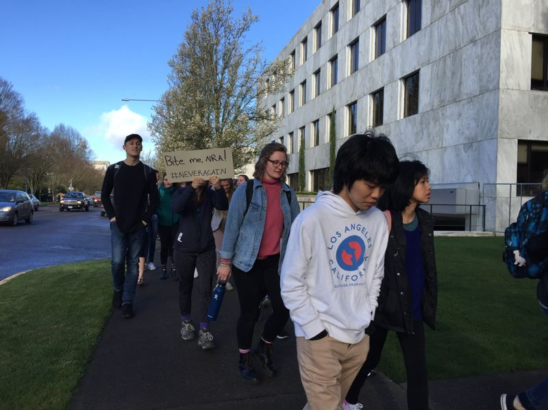 PARIS ACHEN/CAPITAL BUREAU - About 500 Willamette University students and faculty marched around the Oregon State Capitol in Salem during a walkout for national gun safety Wednesday, March 14, 2018.