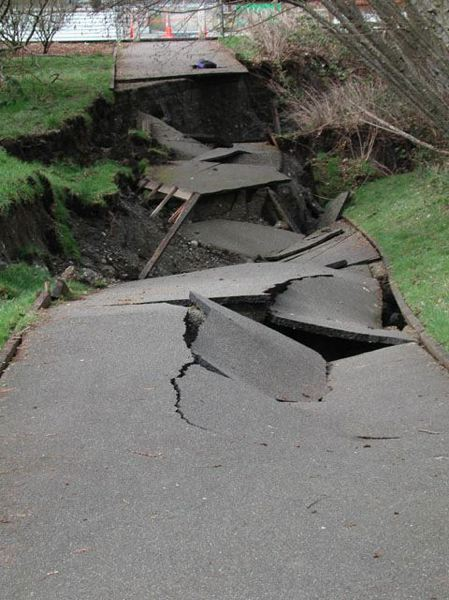 PAMPLIN MEDIA GROUP FILE PHOTO - A collapsed walking path in Olympia, Wash., shows damage from the 2001 Nisqually earthquake. A new report from state geologists says a large quake could cause heavy damage to the region.