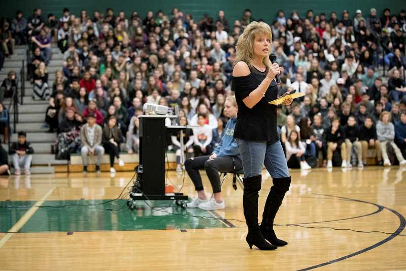 TIMES PHOTO: JAIME VALDEZ - Laura Queen, representing local Sparrow Clubs, talked about Jakob's plight and how to support the teen during an assembly last month. Queen challenged the Tigard students to not only to be compassionate but also to have a connection with other people in their lives.