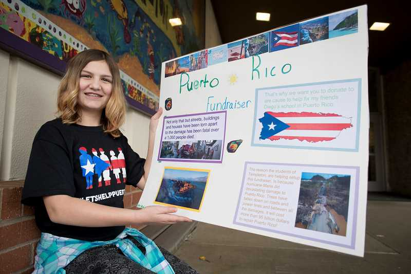 Emily Spector-Van Zee, 11, help set up a fundraiser at Templeton Elementary School set for Saturday to benefit those affected by Hurricane Maria in Puerto Rico.