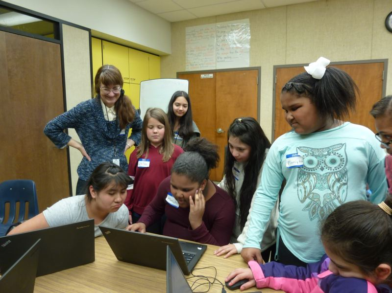 COURTESY PHOTO: AAUW - Fourth and fifth grade students create stories with characters, music and actions, which they learn to code using the online program 'Scratch.'