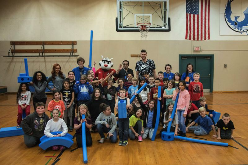 SUBMITTED PHOTO - Group photo at the Boys & Girls Club includes two Blazer dancers, Blaze, Doug Evans and Jusuf Nurkic.