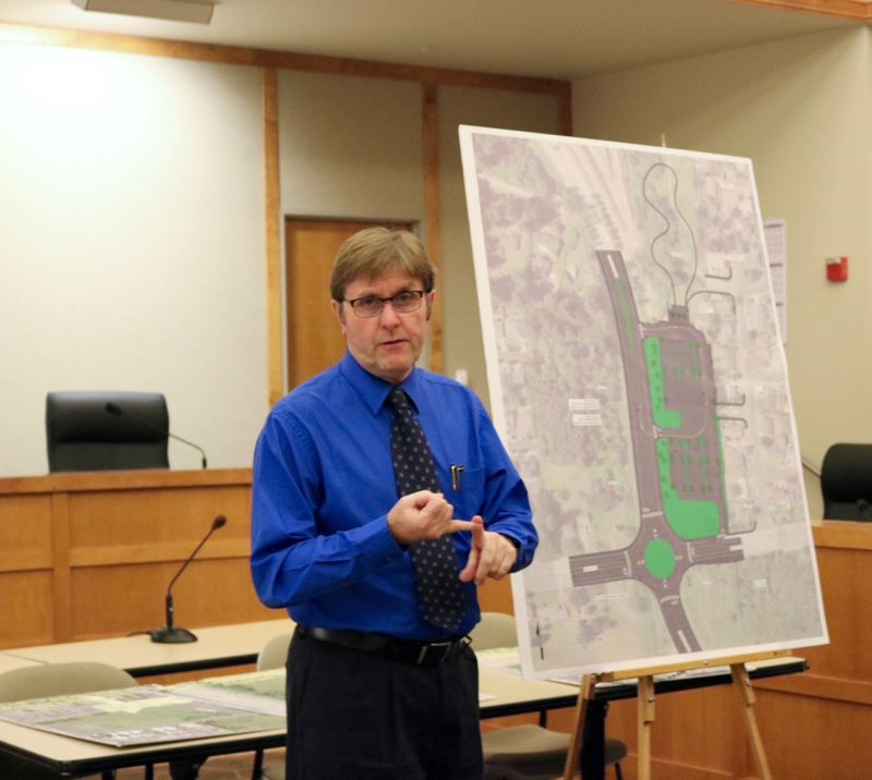 OUTLOOK PHOTO: ZANE SPARLING - Fairview Public Works Director Allan Berry detailed the proposal to build a roundabout, park-and-ride and dog park at the corner of Halsey Street and Fairview Parkway during a three-city meeting on Wednesday, Feb. 28.
