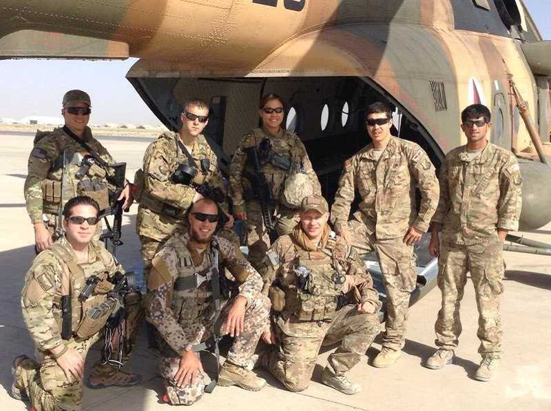 SUBMITTED PHOTO - Mohammed Fawad Mohammadi (second from right in the back row) poses with U.S. soldiers in Afghanistan, where he served an an intrepreter before moving to the U.S. four years ago.