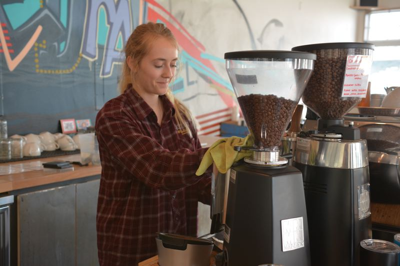 SPOTLIGHT PHOTO: COURTNEY VAUGHN - Leigha Boyer makes an espresso drink at a coffee shop in Scappoose. The Scappoose City Council recently made promotion of small business and economic growth top priorities for the current fiscal year.