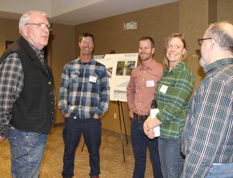HOLLY M. GILL - Roy Hyder, of Metolius, at left, talks with members of the Upper Deschutes Basin Study Group, from left, Niklas Christensen, of the Watershed Professionals Network, Ray Hartwell, of Summit Conservation Strategies, Kate Fitzpatrick, of the Deschutes River Conservancy, and Kyle Gorman, of the Oregon Water Resources Department.