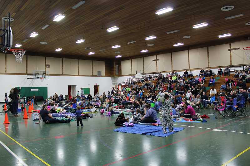HERALD PHOTO: KRISTEN WOHLERS - Students and families gathered at Knight Elementary on March 9 for a viewing of the movie 'Because of Winn Dixie' after having read the book.