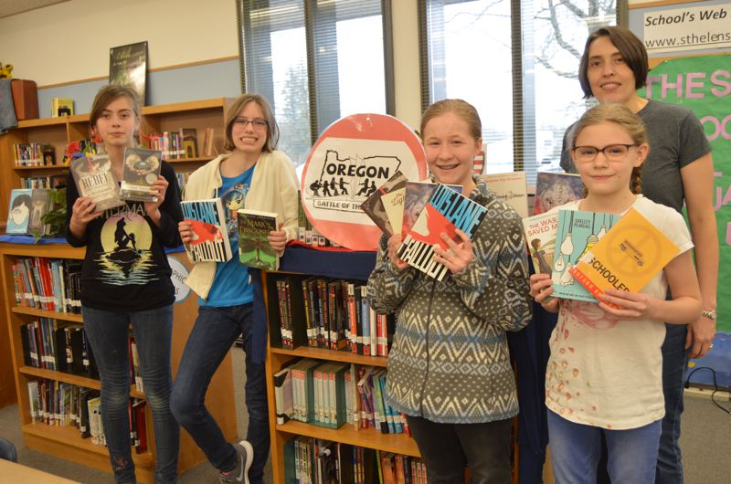 SPOTLIGHT PHOTO: NICOLE THILL - The Bibliophiles team from St. Helens Middle School won first place during the regional Oregon Battle of the Books competition last weekend, and will now head to the state competition in April. Pictured from left to right are Gloria Davis, Hallie McCallum, Allison Cobabb, Bridget Caton and team coach Marsha Caton.