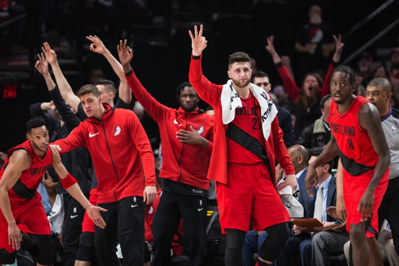 TRIBUNE PHOTO: DAVID BLAIR - Trail Blazers on the sidelines get into it after a 3-point basket falls during Portland's Thursday night homecourt win against Cleveland.