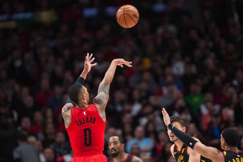 TRIBUNE PHOTO: DAVID BLAIR - Damian Lillard fires a jump shot against Cleveland.
