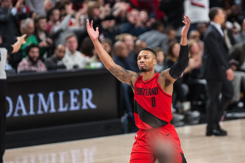 TRIBUNE PHOTO: DAVID BLAIR - Damian Lillard has reason to celebrate.