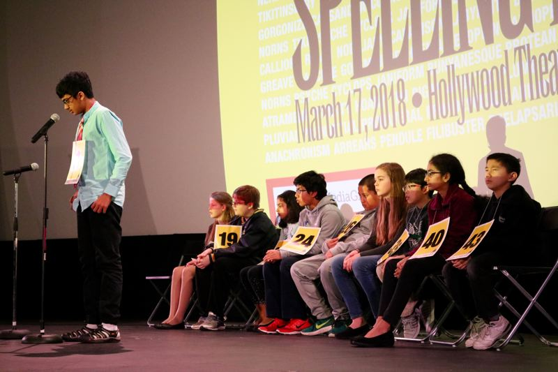 TRIBUNE PHOTO: ZANE SPARLING - Kabir Rathore Muthu, a seventh grader at Access Academy, correctly spells the word 'iridian' during the final rounds of the Regional Spelling Bee on Saturday, March 17 at the Hollywood Theatre in Portland.