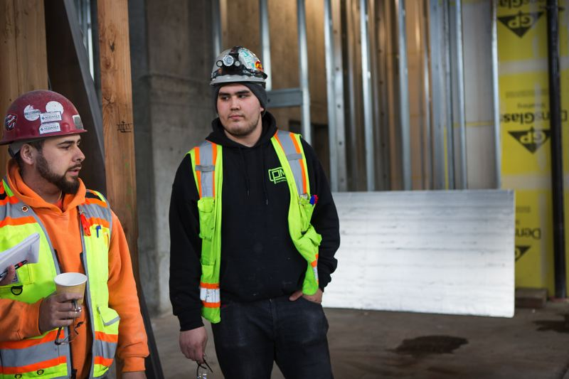 PAMPLIN MEDIA GROUP: ADAM WICKHAM - 19 year old sheet metal apprentice Cristian Torres (right) on the job site with his foreman Junior Fidencio (left).