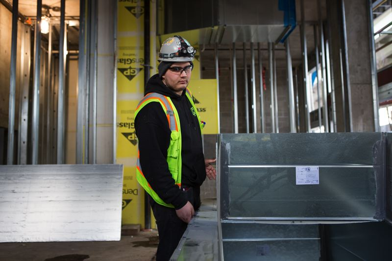 PAMPLIN MEDIA GROUP: ADAM WICKHAM - Torres loves the work because, apart from paying better than most of his friends jobs, it is physical, including lifting and running up stairs, and gives him a sense of accomplishment to see the building rise.