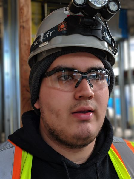 PAMPLIN MEDIA GROUP: JOSEPH GALLIVAN - Torres loves the work because, apart from paying better than most of his friends jobs, it is physical, including lifting and running up stairs, and gives him a sense of accomplishment to see the building rise.