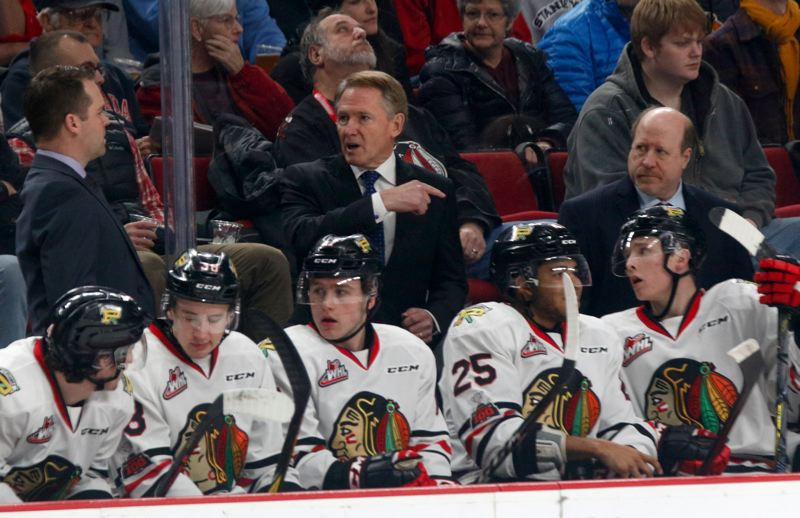 TRIBUNE PHOTO: JONATHAN HOUSE - First-year Portland Winterhawks assistant coach Danny Flynn (right) works the bench during a game with fellow assistant Kyle Gustafson (left) and head coach Mike Johnston.