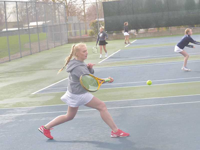 ARCHIVE PHOTO - Canby senior Diana Krishchenko returns to the tennis court to battle it out with the best the Three Rivers League has to offer. Krishchenko lost a tough match against Beaverton in the teams opening contest.