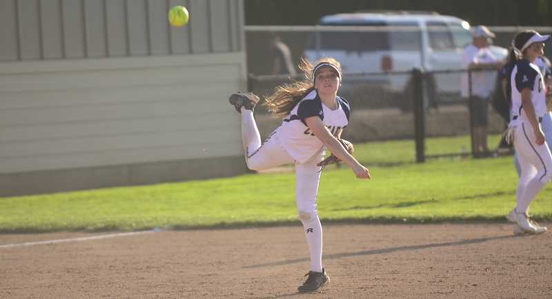 ARCHIVE PHOTO - Canby's softball team finished last season 10-16 overall, and it will be an uphill climb after replacing a pair of its most experience pitchers. Still, the Cougars got the season started off on the right foot by defeating Beaverton 12-3 on Thursday, Mar. 15.