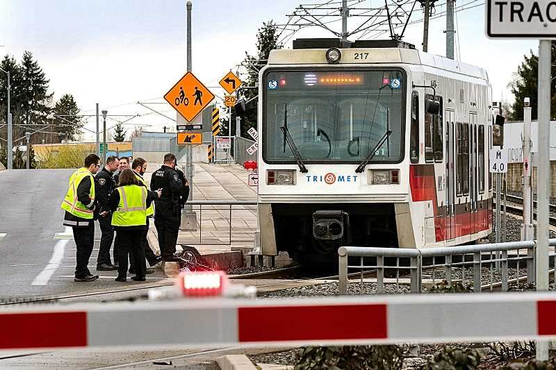 DAVID F. ASHTON - In the Brooklyn neighborhood, the crossing signals were still operating as Portland Police Transit Division and TriMet officials investigate this crash between a MAX Light Rail train and bicyclist.