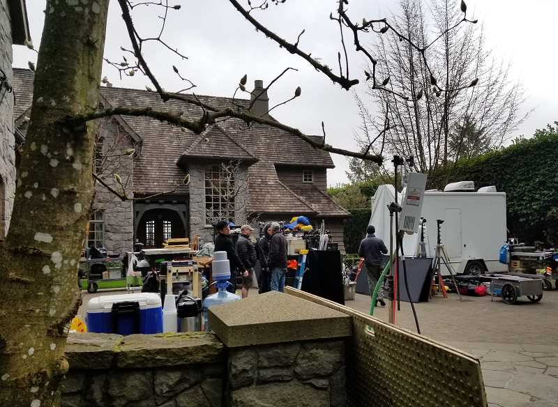 REVIEW PHOTO: GARY M. STEIN - Film equipment fills the driveway of a home Monday morning in the South Shore neighborhood of Lake Oswego, where cast and crew are filming the pilot of a spinoff to the popular TV show 'Pretty Little Liars'.