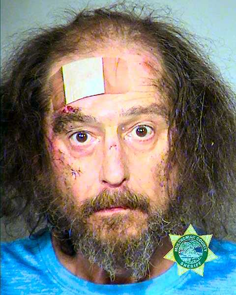MCDC BOOKING PHOTO - 63-year-old Michael Joseph Delsman now faces two felony charges, after assaulting the clerk at a Foster Road market with a sword, and then being held by her for the police.