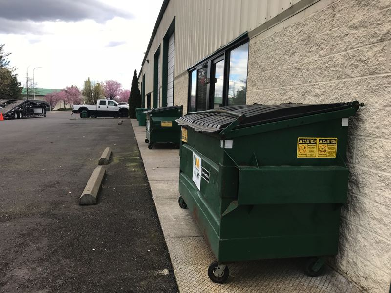 OUTLOOK PHOTO: ZANE SPARLING - Authorities say a suspected sewage scofflaw may not pay for garbage pickup at this business park in Wood Village.