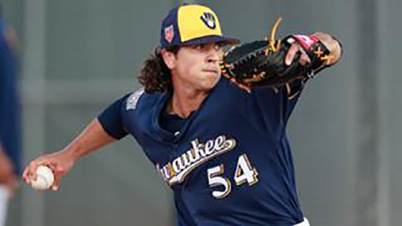 CONTRIBUTED PHOTO: MILWAUKEE BREWERS - Taylor Williams fires a pitch during a spring training game with the Brewers.