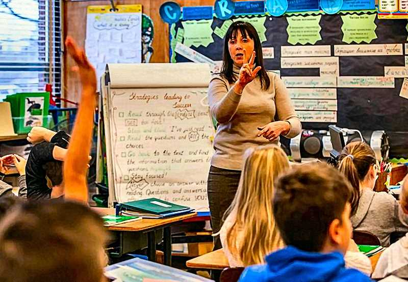 JONATHAN HOUSE - Russian Immersion teacher Olessia Bordioug leads her Kelly Elementary class in Lents through a Russian lesson.