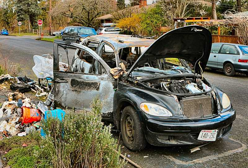 DAVID F. ASHTON - Parked at the curb next to the Sellwood Community Garden, this car caught fire - with a person sleeping inside - in the early morning hours of Thursday, March 1. The person escaped. The car appeared to be registered in Wisconsin.