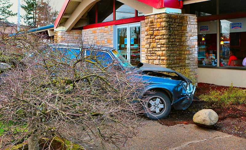 DAVID F. ASHTON - This vehicle, in the shrubbery in front of the IHOP restaurant on S.E. 82nd between Holgate and Foster, was kept out of the restaurant itself by the presence of decorative but sturdy boulders.