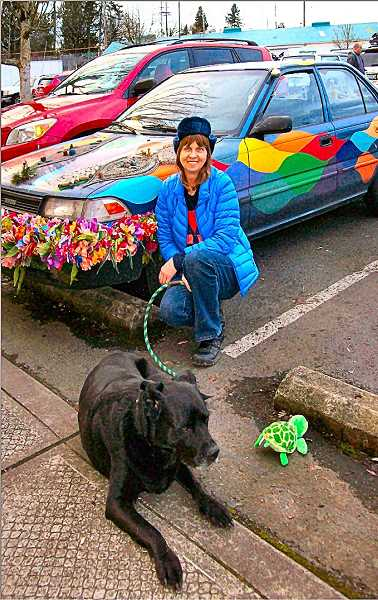 RITA A. LEONARD - Joy Johnston and her rescue dog, Lucky, pose by her current Art Car - Luckys Joyride.