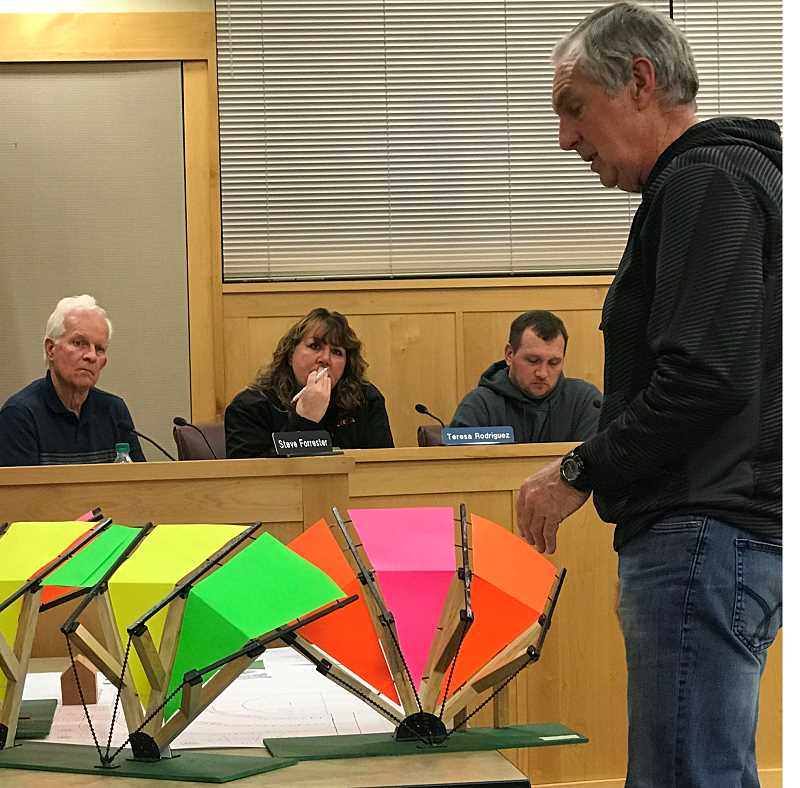 JASON CHANEY - Wayne Looney of Prineville Kiwanis Club explains a model of the shade structures proposed for the new splash pad to members of the Prineville City Council during a meeting last week.