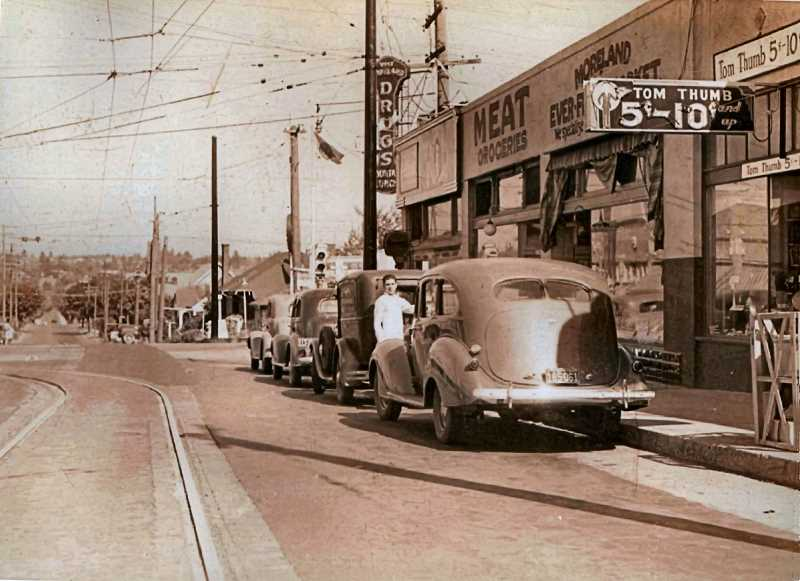 COURTESY OF PORTLAND CITY ARCHIVES - This is the Westmoreland Commercial District in 1937. While cars were lined up along Bybee Boulevard (here, looking east), the sidewalks were pretty vacant of shoppers, since few people had extra spending money in 1937. Business seemed to be slow; a storekeeper was standing outside of Tom Thumbs 5 and 10, with apparently no customers inside to attend to.