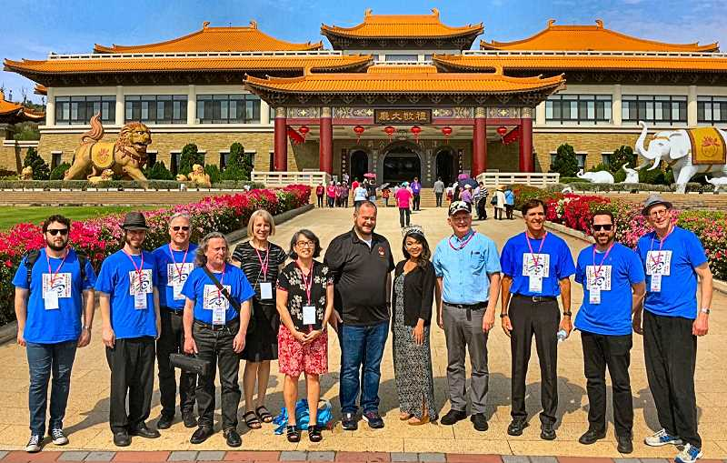 COURTESY OF SUSIE HO, KAOHSIUNG - At a Buddhist Retreat Center, in Kaohsiung, are Sellwood Jazz players in T-shirts. From center left to right: Lisa Revell, Chris Hochstatter (vocalist), Royal Rosarian Prime Minister Adam Baker, 2017 Rose Festival Queen Michaela Canate, and Michael Bostwick, President of the Portland-Kaohsiung Sister City Organization. Sellwood Jazz founder David Stone is at far right.
