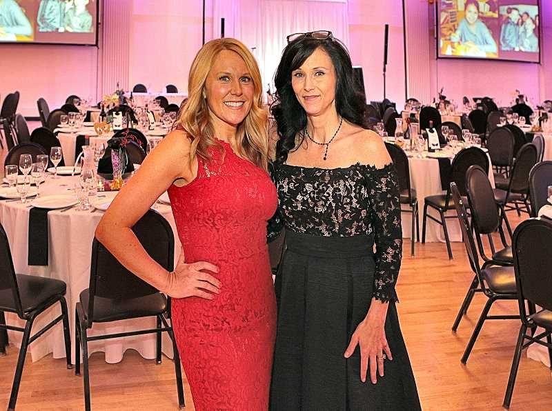 DAVID F. ASHTON - Duniway Foundation Masquerade Ball co-chairs Trisha Highland and Trina Fowler were on hand to greet the arriving guests at the Melody Ballroom on March 2nd.
