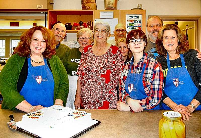 ELIZABETH USSHER GROFF - Shown helping to cook and serve in the All Saints Hot Meals program are, from left, front row: Deborah Swan, Nancy Patrick (coordinator), Sam Kahn, and Katie Essick; back row: Steve Gates, Sarah Cooper, Mark Portrait, Tina Savage, and John Essick.
