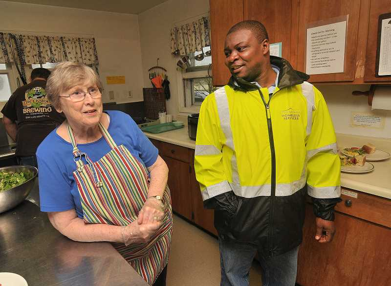 OUTLOOK PHOTO: VERN UYETAKE - Greshams Homeless Services Specialist Aaron Sando chats with longtime Zarephath Kitchen volunteer Bev Anderson during a lunch service.