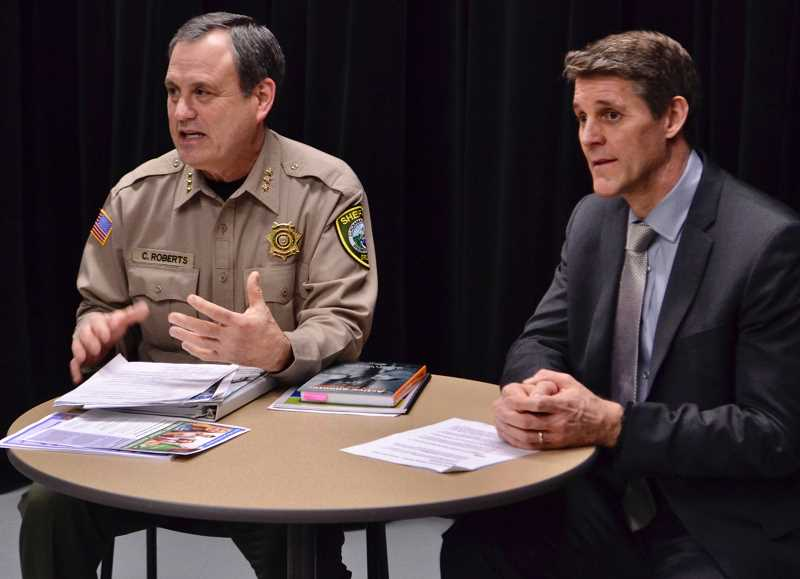 PAMPLIN MEDIA GROUP PHOTO: BRITTANY ALLEN - Clackamas County Sheriff Craig Roberts, left, and FBI Special Agent in Charge Renn Cannon discuss SafeOregon implementation.